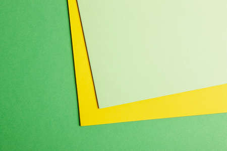 copy: Colored cardboards background in green yellow tone. Copy space. Horizontal Stock Photo