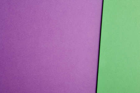 purple abstract background: Colored cardboards background in purple green tone. Copy space. Horizontal