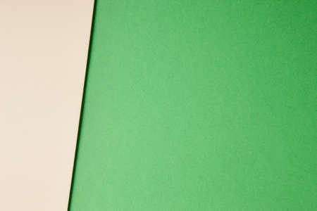 tone on tone: Colored cardboards background in green beige tone. Copy space. Horizontal
