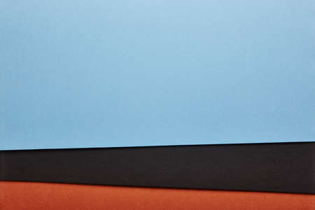 Colored cardboards background in blue black brown tone. Copy space. Horizontal