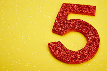 age 5: Number five red color over a yellow background. Anniversary. Horizontal Stock Photo