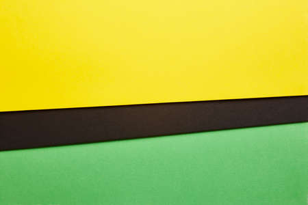 green tone: Colored cardboards background in yellow black green tone. Copy space. Horizontal