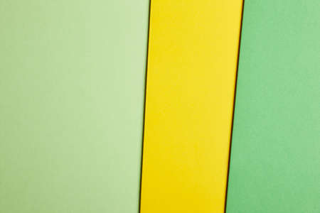 tone: Colored cardboards background in green yellow tone. Copy space. Horizontal Stock Photo