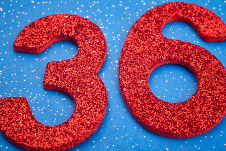 36 6: Number thirtysix red color over a blue background. Anniversary. Horizontal