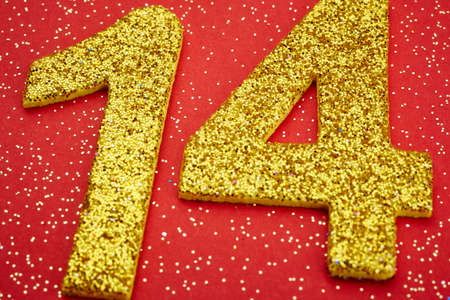 fourteen: Number fourteen yellow color over a red background. Anniversary. Horizontal Stock Photo