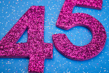 age 5: Number fortyfive purple color over a blue background. Anniversary. Horizontal