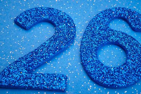 Number twentysix blue color over a blue background. Anniversary. Horizontal