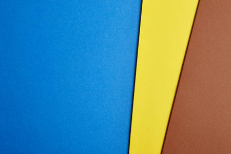 paperboard: Colored cardboards background in blue yellow brown tone. Copy space. Horizontal
