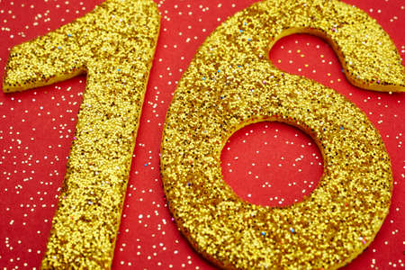 sixteen: Number sixteen yellow color over a red background. Anniversary. Horizontal