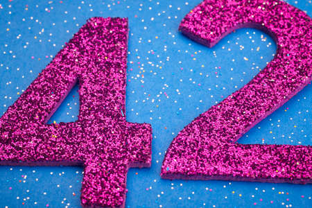 40: Number fortytwo purple color over a blue background. Anniversary. Horizontal