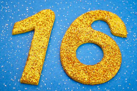 sixteen: Number sixteen yellow color over a blue background. Anniversary. Horizontal