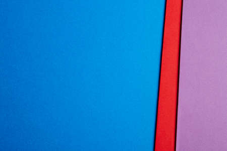 Colored cardboards background in blue red purple tone. Copy space. Horizontal Stock Photo
