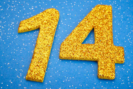 fourteen: Number fourteen yellow color over a blue background. Anniversary. Horizontal Stock Photo
