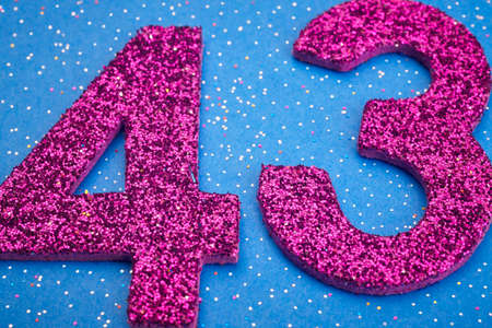40: Number fortythree purple color over a blue background. Anniversary. Horizontal Stock Photo