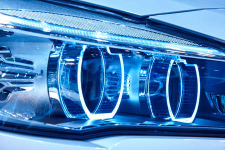 vehicle part: Car light detail in blue tone. Vehicle part. Vertical format