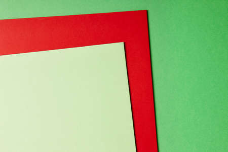 green and red: Colored cardboards background in green red tone. Copy space. Horizontal