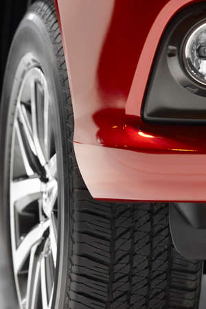 alloy: Red car body and alloy wheels detail. Vertical Stock Photo