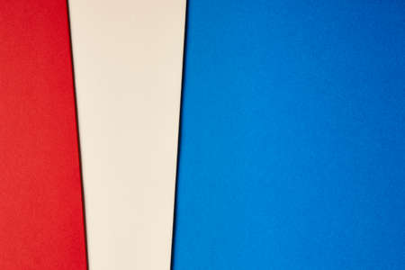 tone: Colored cardboards background in blue beige red tone. Copy space. Horizontal