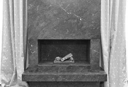stone fireplace: Minimalism stone fireplace. Apartment interior detail. Black white