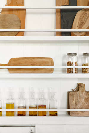 kitchen cabinets: Kitchen rackets cabinets with oil bottles and accessories. Vertical