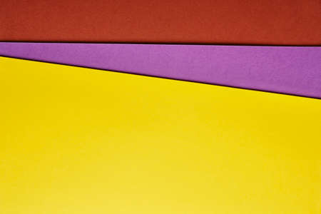 Colored cardboards background in yellow purple red tone. Copy space. Horizontal