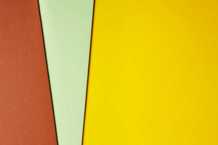 Colored cardboards background in yellow green brown tone. Copy space. Horizontal Stok Fotoğraf