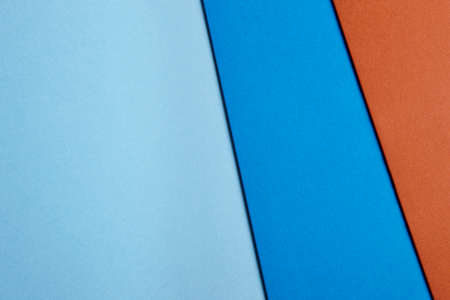 Colored cardboards background in blue brown tone. Copy space. Horizontal