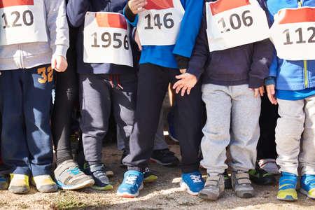 start to cross: Children athletics runner on a cross country race. Start line. Horizontal