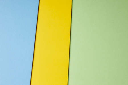 green tone: Colored cardboards background in blue yellow green tone. Copy space. Horizontal Stock Photo