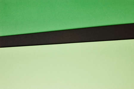 tone: Colored cardboards background in green black tone. Copy space. Horizontal Stock Photo