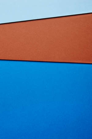 Colored cardboards background in blue brown tone. Copy space. Vertical