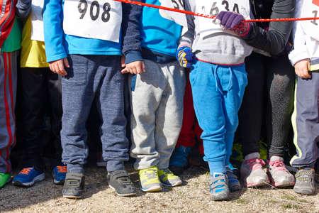 start to cross: Children athletics runner on a cross country race. Start. Horizontal