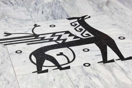 Norwegian sign symbol with winged dragon. Black marble stone. Horizontal
