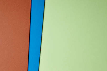 tone: Colored cardboards background green blue brown tone. Copy space. Horizontal