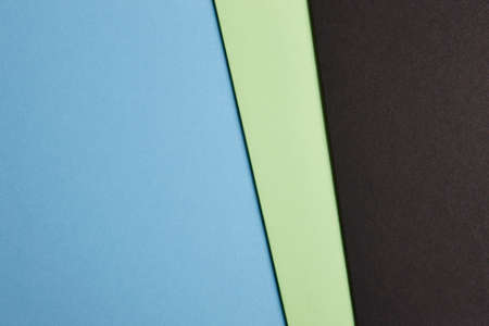 tone on tone: Colored cardboards background blue green black tone. Copy space. Horizontal