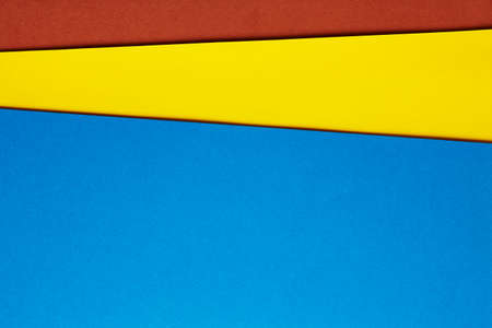 tone on tone: Colored cardboards background blue yellow brown tone. Copy space. Horizontal Stock Photo