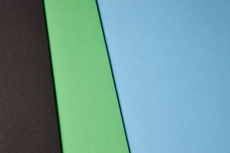 tone on tone: Colored cardboards background black green blue tone. Copy space. Horizontal