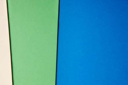 tone on tone: Colored cardboards background beige green blue tone. Copy space. Horizontal