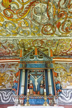 church interior: Traditional norwegian wooden church interior. Altar detail. Stordal. Vertical