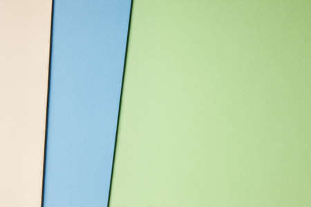 green tone: Colored carboards background in beige blue green tone. Copy space. Horizontal