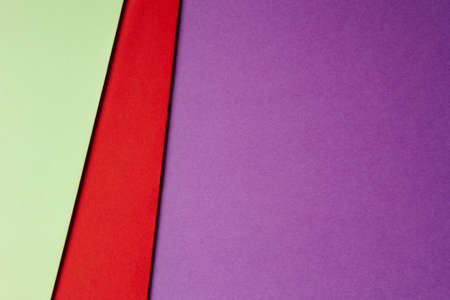 paperboard: Colored cardboards background in green red purple tone. Copy space. Horizontal