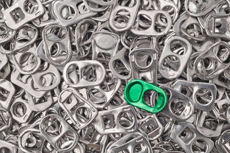 aluminum background: Recycling aluminum background with pull-tab pieces. Metallic waste. Horizontal