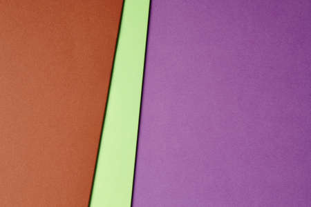 Colored cardboards background in brown green purple tone. Copy space. Horizontal