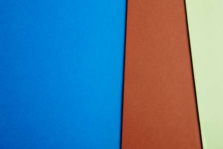 paperboard: Colored cardboards background in blue brown green tone. Copy space. Horizontal