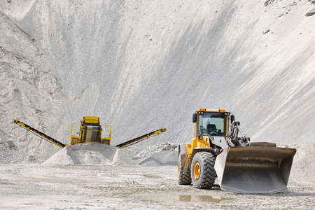 heavy industry: Quarry aggregate with heavy duty machinery. Construction industry. Horizontal