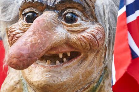 troll dolls: Norway. Troll head with norwegian flag. Scandinavian symbol. Horizontal