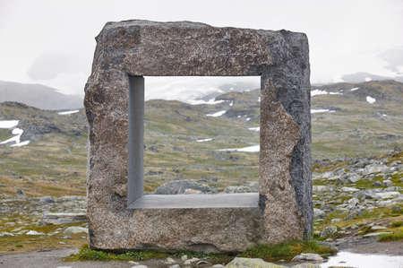 Norwegian mountain foggy landscape with rock sculpture. Norway trekking Stock Photo
