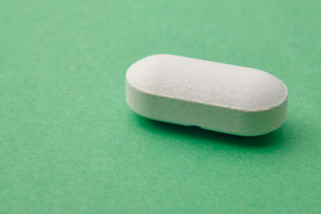 medicament: Pill over a green background. Medicament treatment. Health care photo