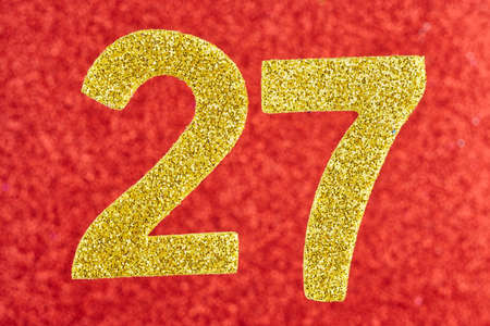 Number twenty-seven yellow color over a red background. Anniversary. Horizontal Stock Photo