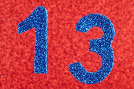 Number thirteen blue color over a red background. Anniversary. Horizontal Stock Photo